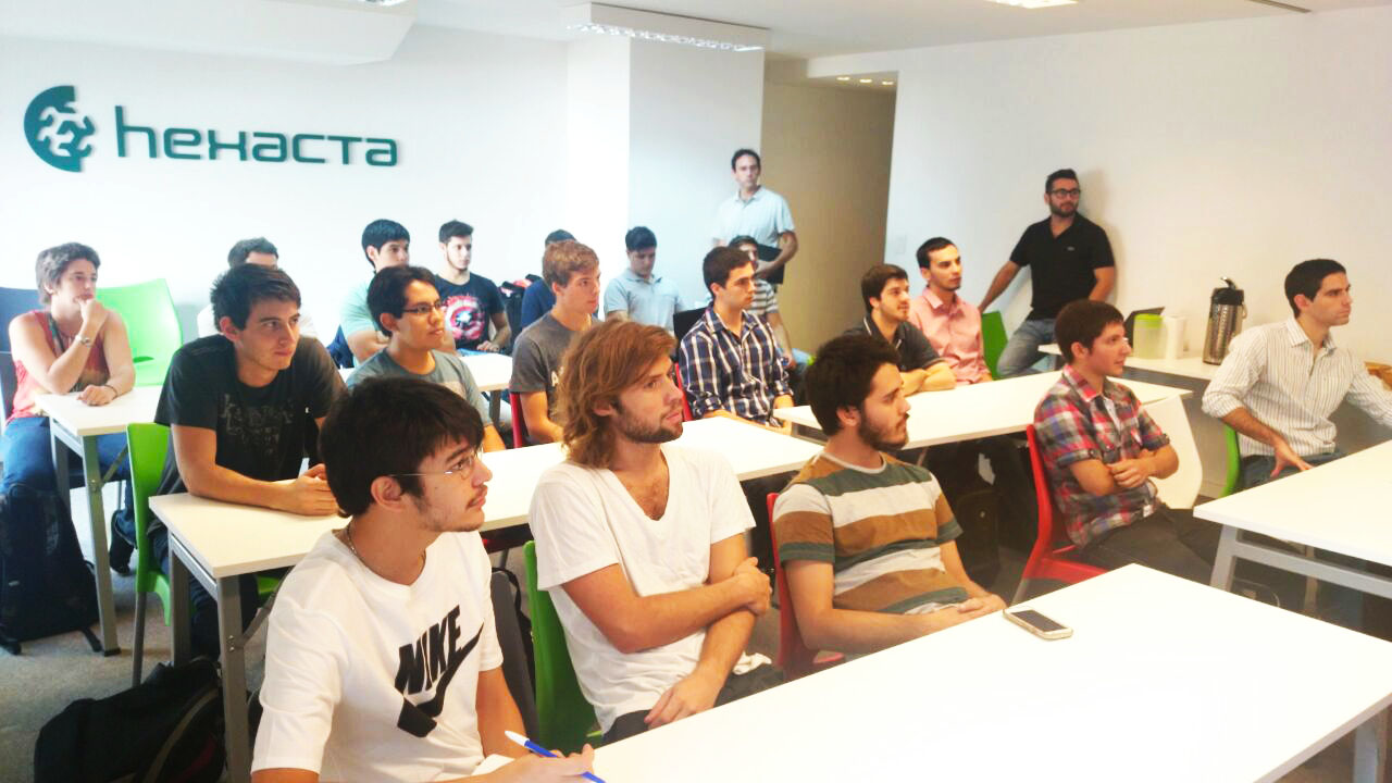 Accept the Challenge high school students at Hexacta's offices