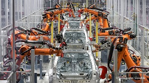 Robots building cars inside a factory