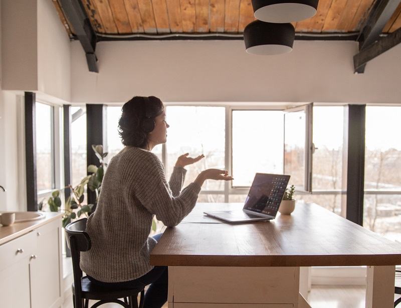 Woman in a kitchen having remote work