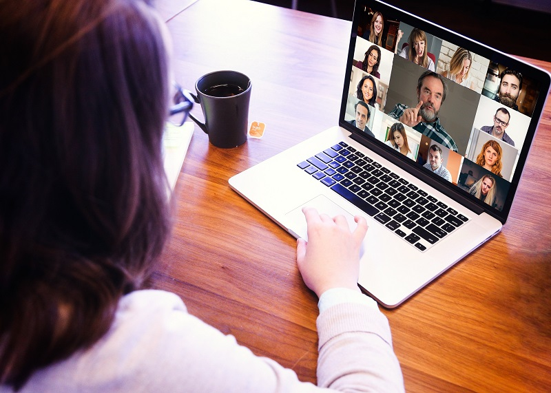 Woman having an online meeting with many people