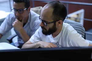 Two developers working at Hexacta's office