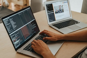 One person coding net core and working on two computers