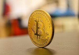 Gold coin with the sign of Bitcoin