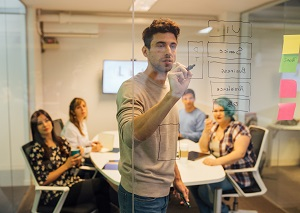 Architect software drawing over a window with a group of people behind him